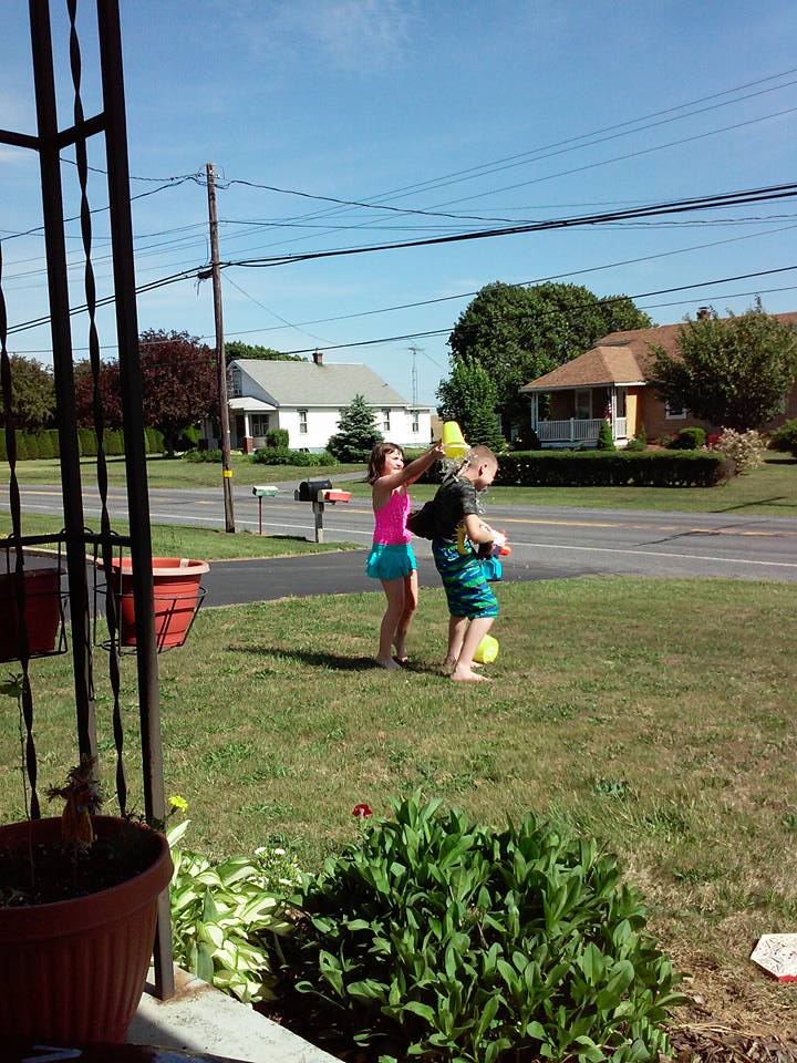 A family water war is a great way to beat the heat and have some fun without spending a dime!